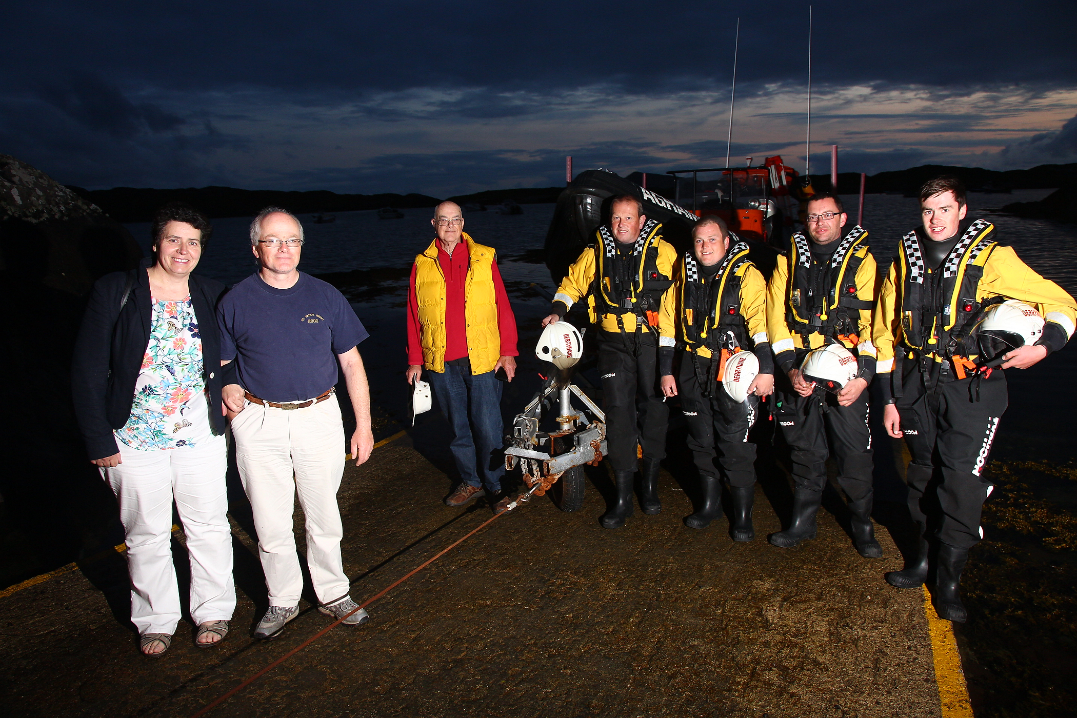 Colm Plunkett with wife visiting the Derrynane Inshore Crew. L-R David O Mahony (Secretary), Jerry Clifford (Helm), Richard Frewin (Crew), Jonathon Hughes(crew), Mikey Martin (crew).